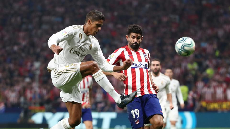 Atletico Madrid v Real Madrid - Wanda Metropolitano, Madrid, Spain - September 28, 2019 Real Madrid's Raphael Varane in action with Atletico Madrid's Diego Costa REUTERS/Sergio Perez