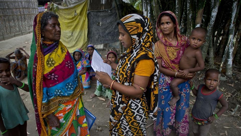 Women check their eligibility for NRC, in Assam.