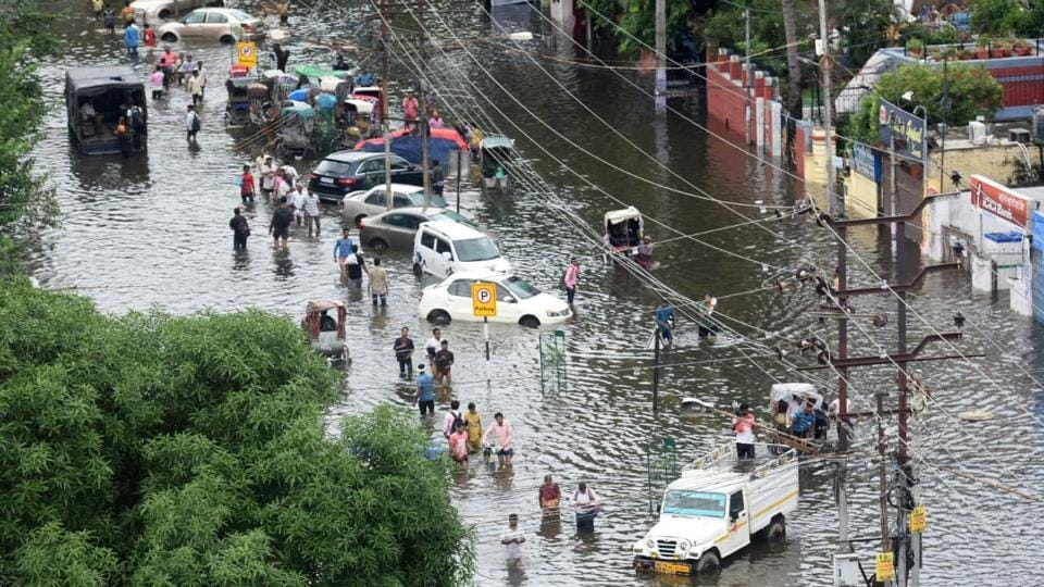 Commuters stranded on a waterlogged road owing to heavy rainfall, in Patna, Bihar. At least 134 people have died in rain-related incidents across the country in the past three days, with Uttar Pradesh reporting the maximum cases and Bihar capital Patna reeling under knee-deep water due to the sudden spurt in late monsoon rainfall. (Parwaz Khan / HT Photo)