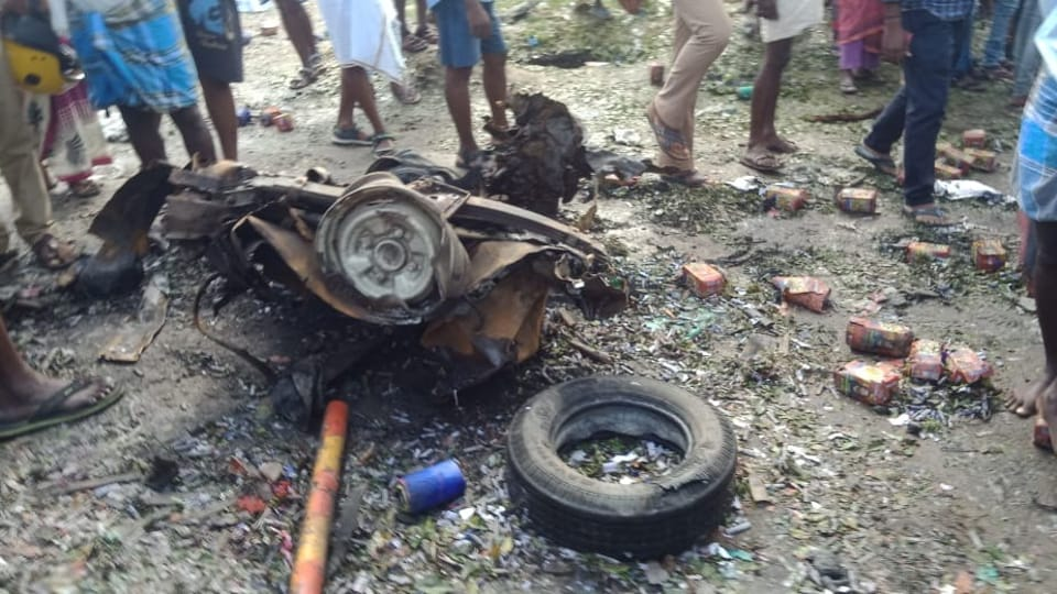 The remains of the van that exploded inTamil nadu's Villupuram district on Monday