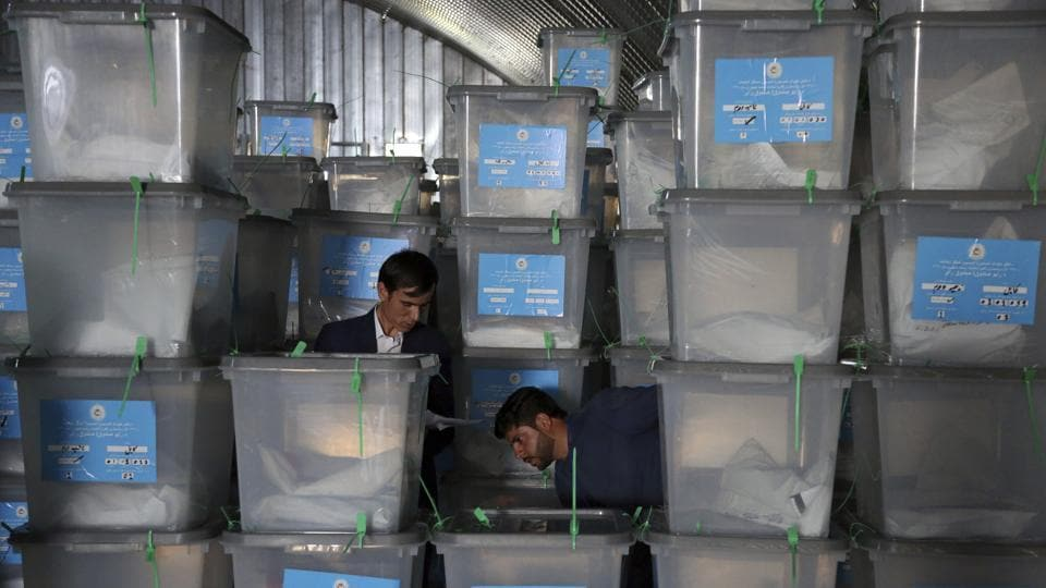 Afghan election workers stack ballot boxes at the warehouse of Afghanistan's Independent Election Commission in Kabul, Afghanistan, Sunday, Sept. 29, 2019. Presidential elections are over, and Afghanistan faces possible political chaos amid allegations of power abuse and a disorganized, sloppy voting process. A final tally is only expected Nov. 7, deepening uncertainty.