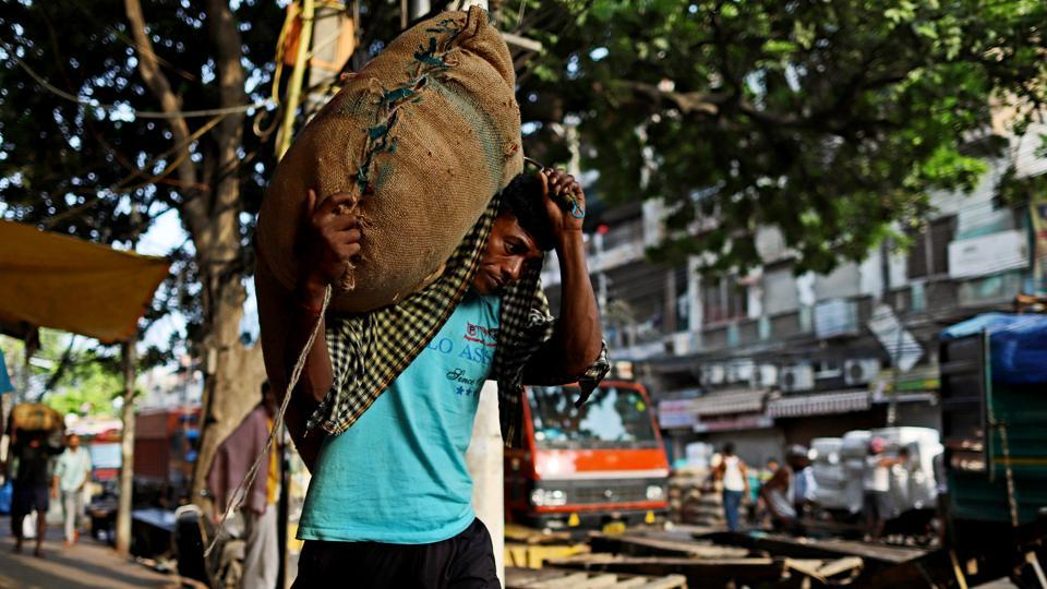 A worker carries a sack at a wholesale market in Delhi. The official said there will be extensive focus on promoting Apprenticeship training