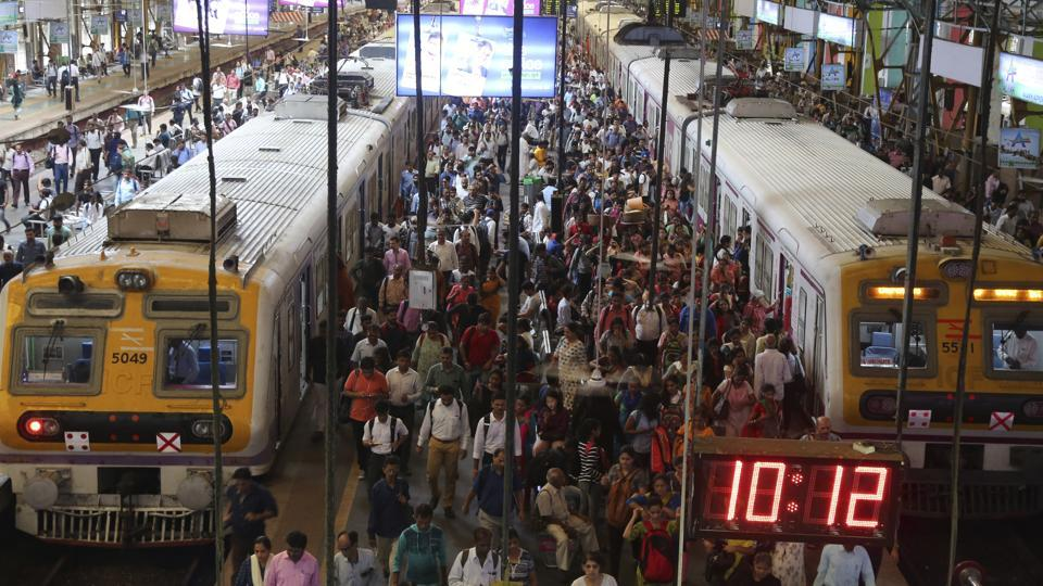 Indian commuters crowd the Churchgate railway station in Mumbai, India Friday, July 5, 2019. Indian Prime Minister Narendra Modi's government has proposed to invest heavily in infrastructure, digital economy and job creation to lift a slugging economy that's burdened with a 45-year-high unemployment rate of 6.1 percent. (AP Photo/Rafiq Maqbool)