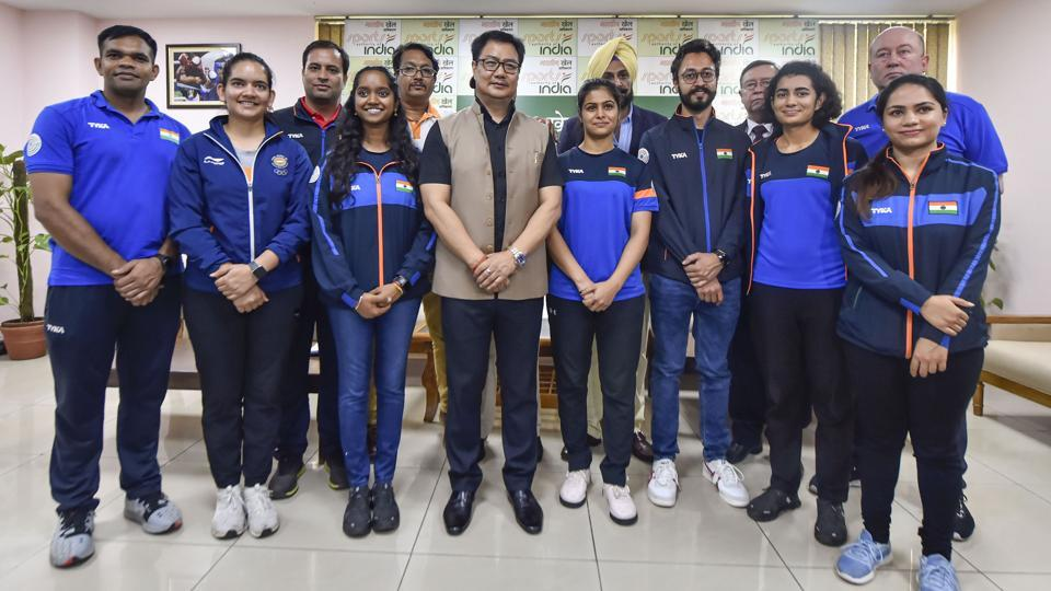 Union Sports Minister Kiren Rijiju in a group photo with members of the Indian shooting team.