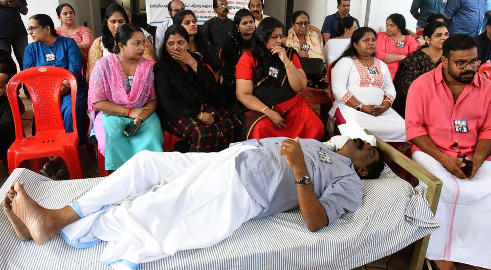 Kerala, Sep 29 (ANI): Residents of Maradu flats begin a hunger strike demanding more time for moving out of their apartments that have been slated for demolition in Ernakulam on Sunday. (ANI Photo)