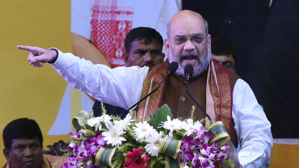 BJP president and Union Home minister Amit Shah at Netaji Indoor stadium during a Party programme on NRC in Kolkata on Tuesday.