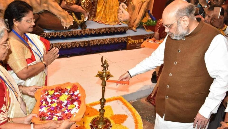 BJP national president and Union home minister Amit Shah inaugurating a Durga Puja in Kolkata's satellite township of Salt Lake on Tuesday.