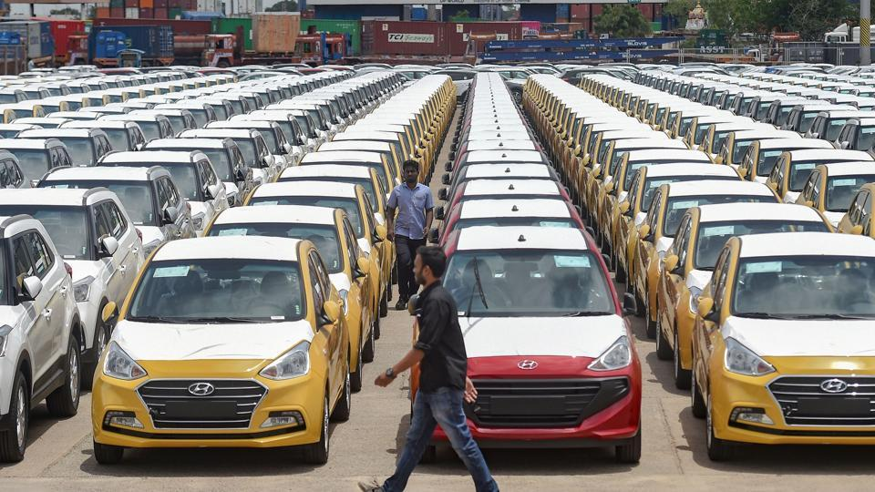 Cars are seen parked in a dock. Goa government has slashed road tax on purchases of new vehicles for a period of three months, in a bid to help the struggling auto industry.