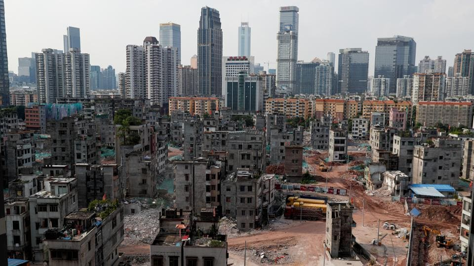 The area of Xiancun, which is in the process of redevelopment, is seen from a new apartment block in Guangzhou. It is one of the 'urban villages' that represent the disparities of modern China. While Xiancun's cramped streets once offered affordable homes for migrants drawn to Guangzhou's prosperity and opportunities, it is now being swept away by redevelopment. (Jorge Silva / REUTERS)