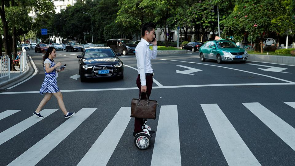 A man rides a hoverboard in the business district of Guanghzou. A city of 14 million, Guangzhou is no stranger to the disruption brought about by breakneck economic change. Once China's only port open to foreign trade, Guangzhou prides itself on being a bastion of southern Chinese culture and thought. The city has thrived since China opened itself to the outside world in the late 1970s. (Jorge Silva / REUTERS)