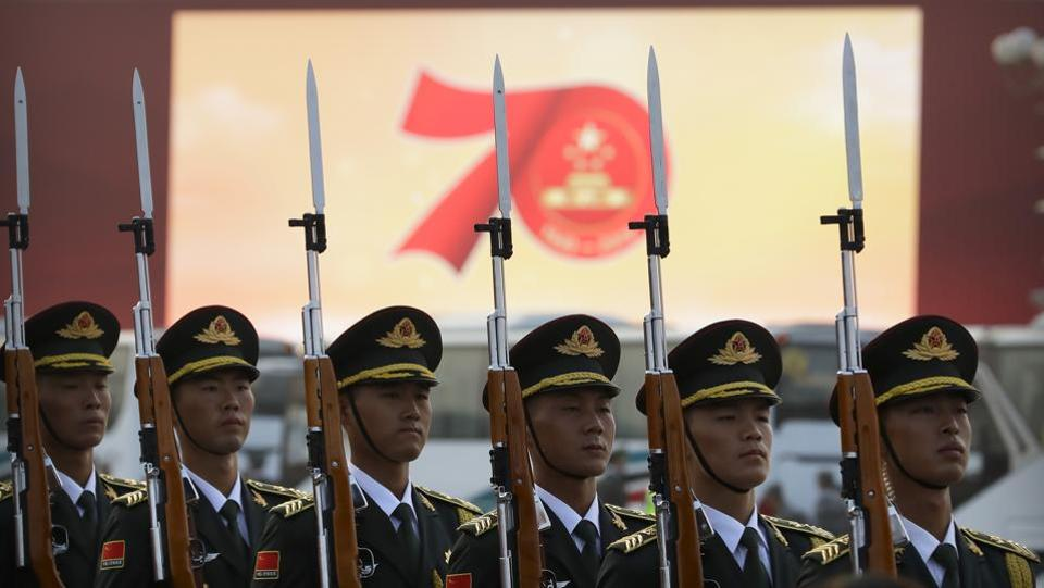 "Members of a Chinese military honour guard stand at attention during a rehearsal before the parade in Beijing.  In his speech, Xi said China ""must adhere"" to the one country, two systems policy governing Hong Kong and ""maintain the long-term prosperity and stability"" of the city. (Mark Schiefelbein / AP)"