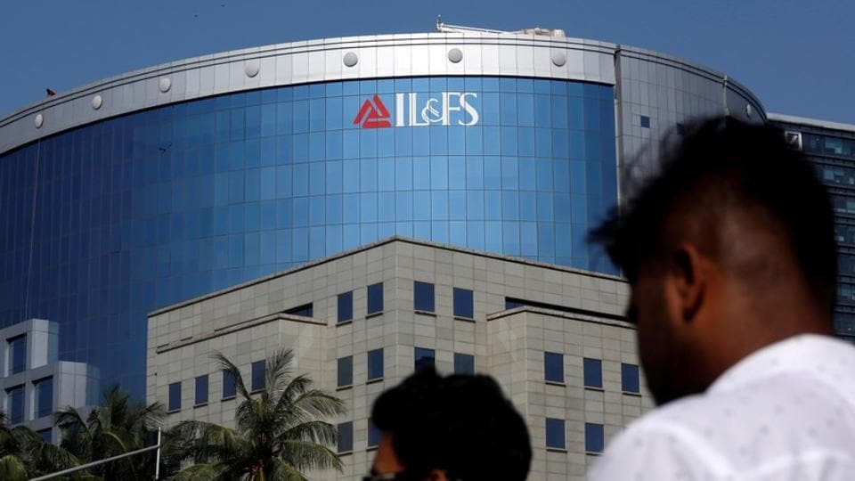People walk past a building of IL&FS (Infrastructure Leasing and Financial Services Ltd.) outside its headquarters in Mumbai, India, September 25, 2018.