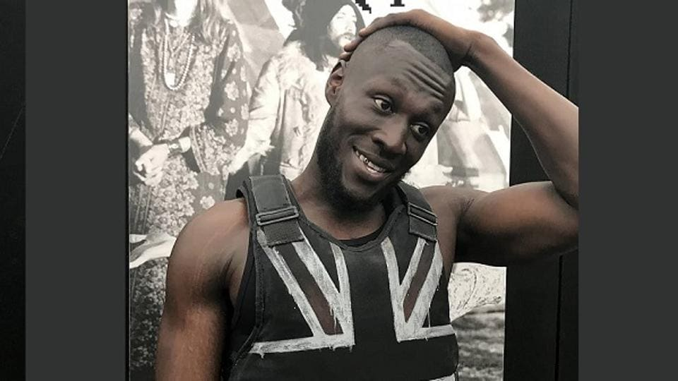 Scores of people vied for a view of some of the guerilla graffiti artist's works, including the stab vest he designed for grime artist Stormzy (pictured) to wear during his headline performance at this year's Glastonbury Festival. (Instagram/banksy)
