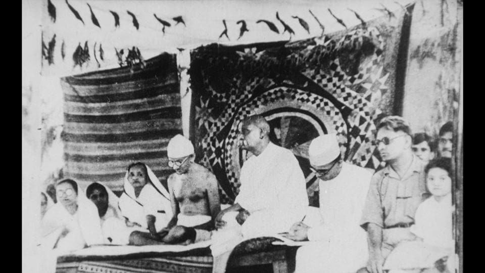 "Gandhi with Sardar Vallabhai Patel during the Bardoli Satyagraha, in Gujarat, 1928. The Mahatma came up with the term Satyagraha - literally, ""holding on to truth"" or, as Gandhiji variously described it, truth-force, love force or soul-force – to describe his method of action in terms that also imbued it with moral content and authority. This philosophy enabled the farmers in Bardoli to challenge the unfair taxes that were levied on them by the government. (National Gandhi Museum)"