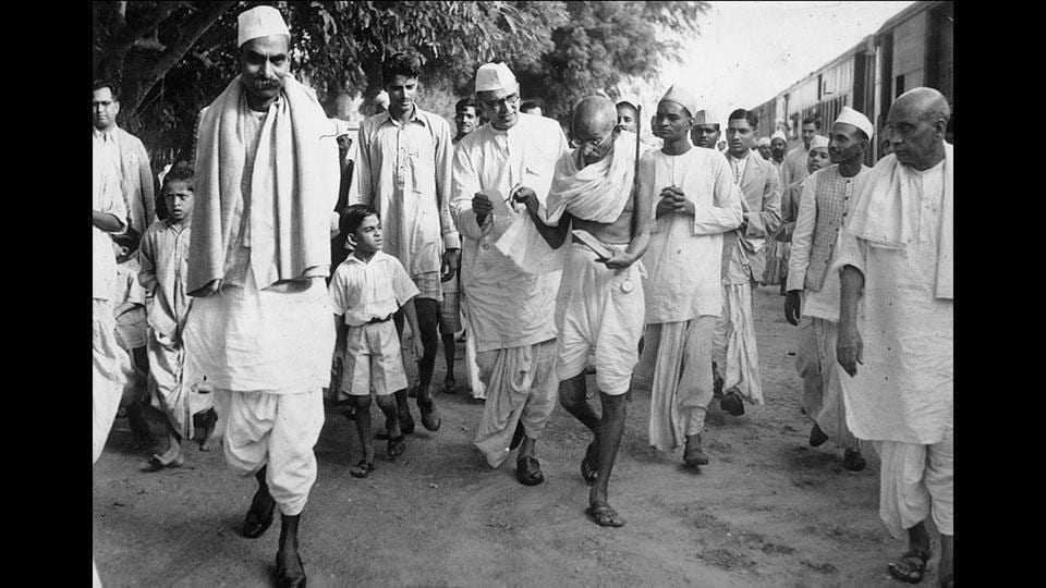 Mahatma Gandhi arrives in Delhi with members of his staff to confer with Viceroy Lord Linlithgow on the question of the war, on October 12, 1939. To the left of Gandhi is his associate Mahadev Desai and further left is Rajendra Prasad, who went on to become independent India's first president. (National Gandhi Museum)