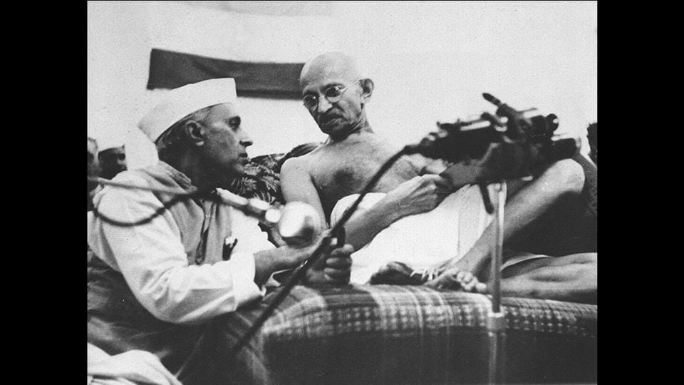 Jawaharlal Nehru, left, and Mahatma Gandhi converse at a session of the Indian National Congress in Gowalia Tank, Bombay, India, a few hours before their arrest on August 8, 1942. A day after the All India Congress committee passed the Quit India resolution, Gandhi along with Mahadev Desai, Sarojini Naidu and Mira Behn were arrested from GD Birla's house in Malabar hill where they were staying. (National Gandhi Museum)