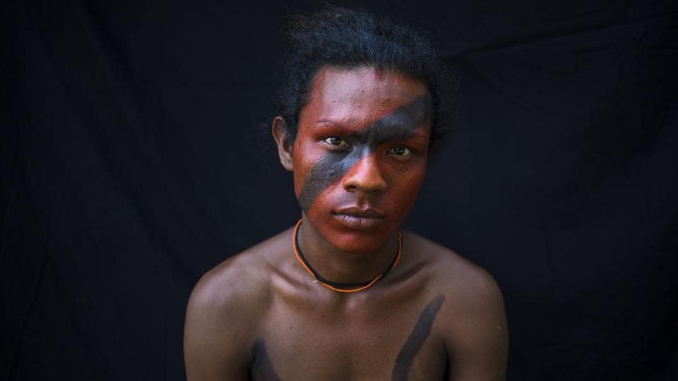 Genilson Tembe, 22, poses for a portrait during a gathering of Tembe tribes in the Tekohaw village. The members of the tribe use the black dye extracted from the Jenipapo tree to mark the moment when the young reach adulthood and daub themselves in the red dye from the urucum seeds to prepare for battle.   (Rodrigo Abd / AP)