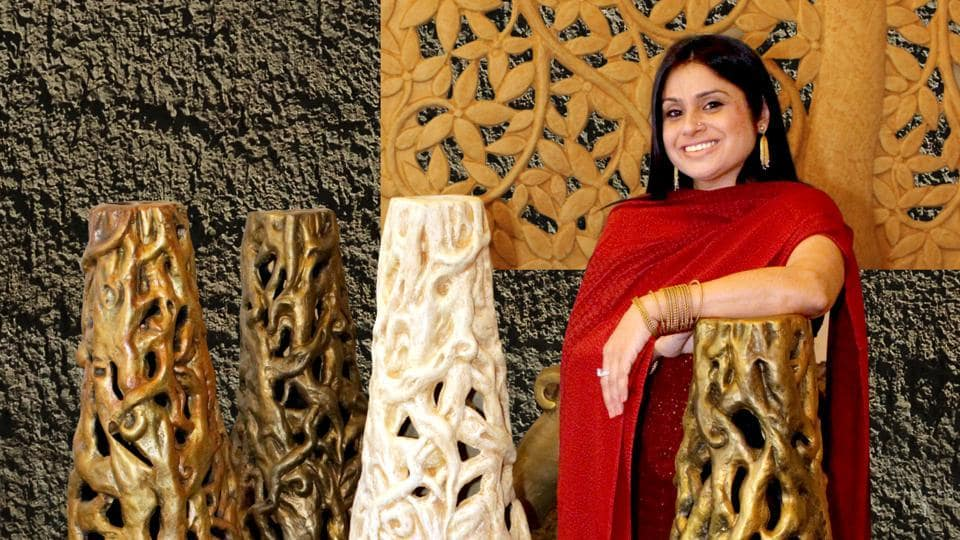 Anju Kumar's annual show displays her artworks that comprise a gold leafing floral mural, swarna mural, boat urli, abstract vases with gold motifs, artworks, table stands, floor lamps, tulsi chauras, pillars, chowkis, and diyas, along with a series of Buddhas in meditative and serene moods, and sculptures of Ganesha.