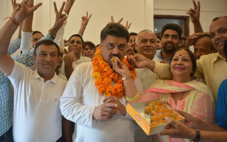 Congress candidate Chander Mohan with his supporters at his residence in Panchkula on October 3.