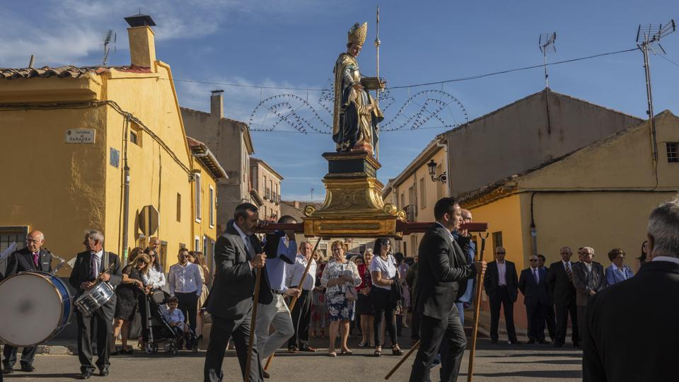 Villagers carry the carving of Saint Toribio during an afternoon procession . Attendance remains strong at the festival, which locals call El Vítor, but there are widespread worries in the wind-swept rural town as families and young adults keep leaving Mayorga for cities with jobs and better services. (Bernat Armangue / AP)