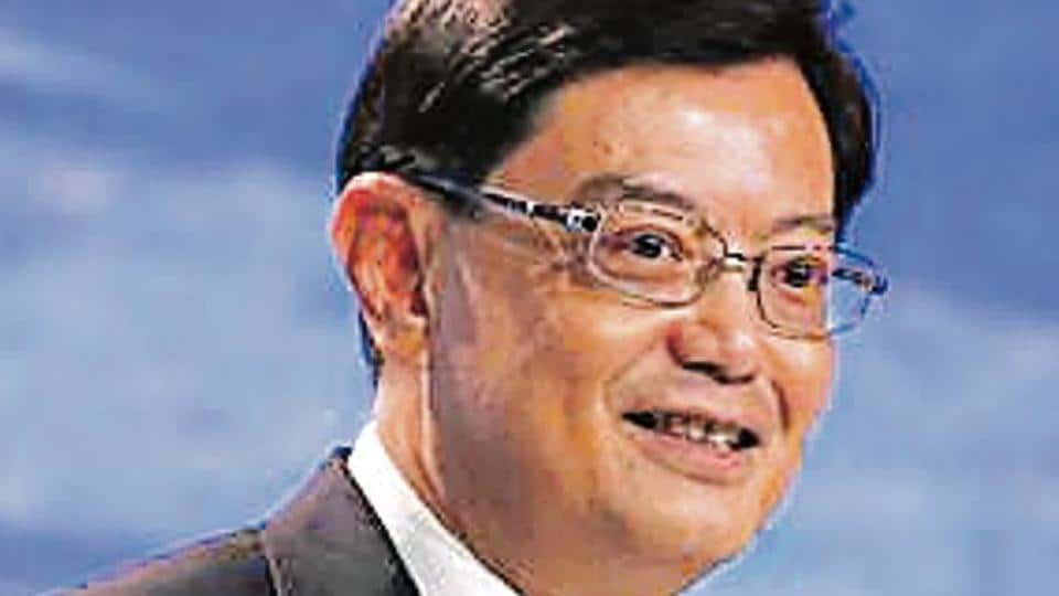 The world economy is at a crossroads with many countries adopting protectionism while looking to deepen globalization, Singapore's deputy prime minister, Heng Swee Keat, said