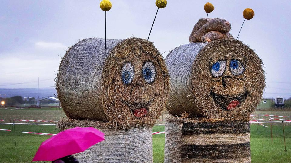 Figures made of straw bales stand on a meadow in the small village of Weiskirchen near Frankfurt, Germany. (Michael Probst / AP)