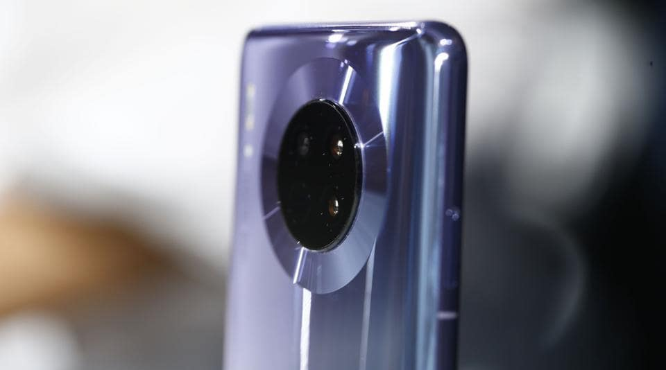 A quad-camera lens array sits on the back of a Huawei Technologies Co. Mate 30 smartphone during the device's unveiling in Munich, Germany, on Thursday, Sept. 19, 2019.