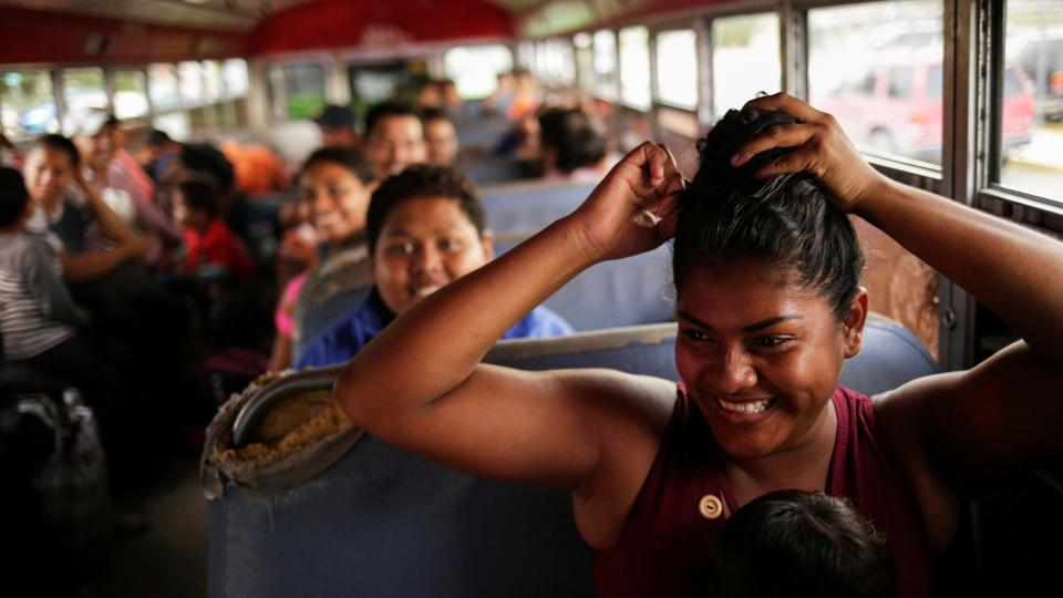 Mexicans fleeing from violence, and who are camping near the Santa Fe international border crossing bridge while waiting to apply for asylum to the US, are seen on a bus as they are moved to a shelter due a storm forecast in Ciudad Juarez, Mexico. (Jose Luis Gonzalez / REUTERS)