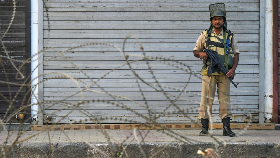 Security personnel stands guard during shutdown, in Srinagar, Sunday, Sept. 29, 2019.