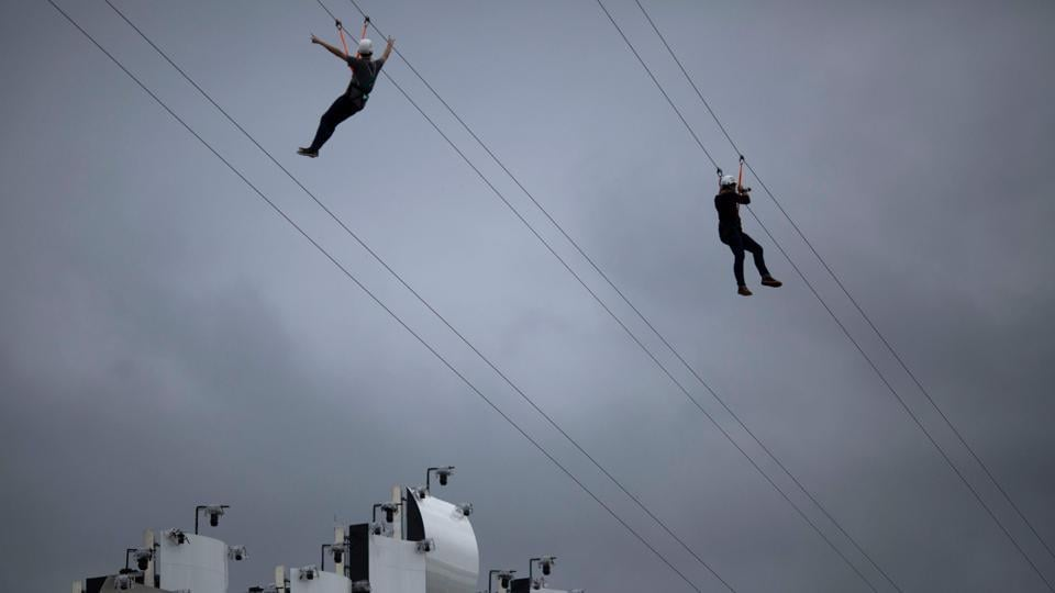 Fans ride on a zip line mounted in front of the main stage of the Rock in Rio festival at the Olympic Park, Rio de Janeiro, Brazil. The week-long Rock in Rio festival started September 27, with international stars as headliners, over 700,000 spectators and social actions including the preservation of the Amazon. (Mauro Pimentel / AFP)