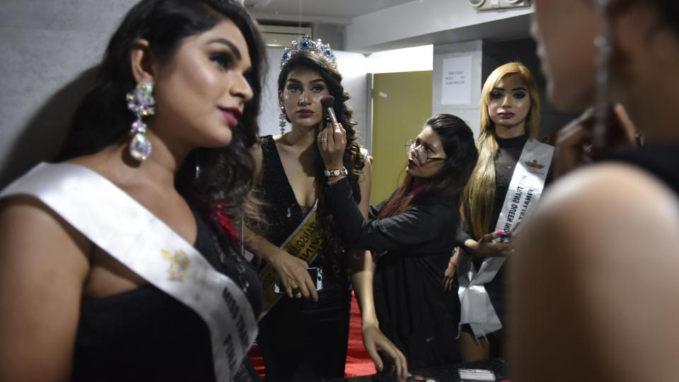 A contestant gets ready for the show. The participants were taught on the nuances of applying cosmetics like foundation, blusher, mascara. They learnt how to make different hairstyles, how to walk the ramp with high heels and to take care of skin and fitness. (Raj K Raj / HT Photo)