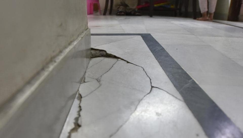 Cracks seen on the floor of a house at Begumpur Village, in New Delhi. Residents of the area say the cracks have appeared due to the Metro trains passing in the tunnel underneath their houses.
