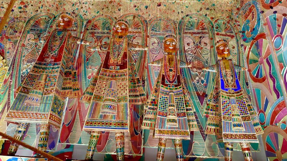 With the theme as 'colour,' the idols at Samaj Mudiali club have been created by artist Gauranga Kuilya. The pandal has been made of acrylic sheet with glass painting. (Samir Jana / HT Photo)