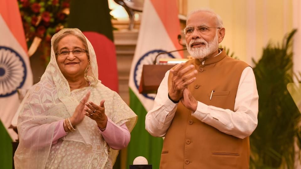 Prime Minister Narendra Modi with his Bangladeshi counterpart Sheikh Hasina applaud after launching a bilateral project, at Hyderabad House in New Delhi, Saturday, Oct. 5, 2019.