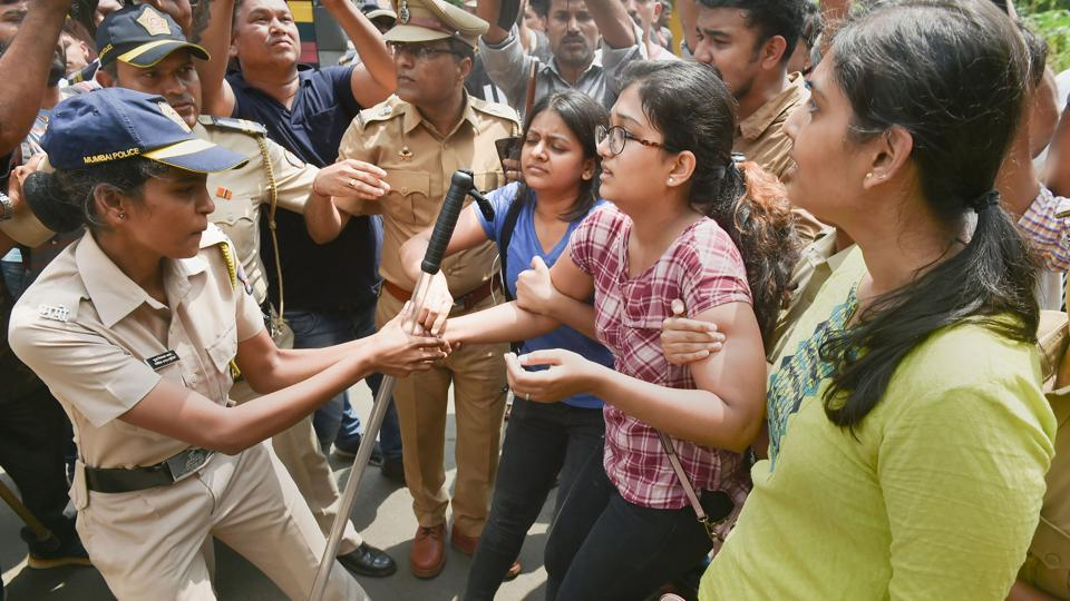 Police detain activists protesting against the felling of trees for the metro car shed project at Aarey Colony in Mumbai. Section 144 of the Criminal Procedure Code was imposed in the colony and surrounding areas on Saturday, banning unlawful assembly following demonstrations. The move to fell trees is a major setback for activists who have been drawing attention to the environmental implications of such action. (Mitesh Bhuvad / PTI)