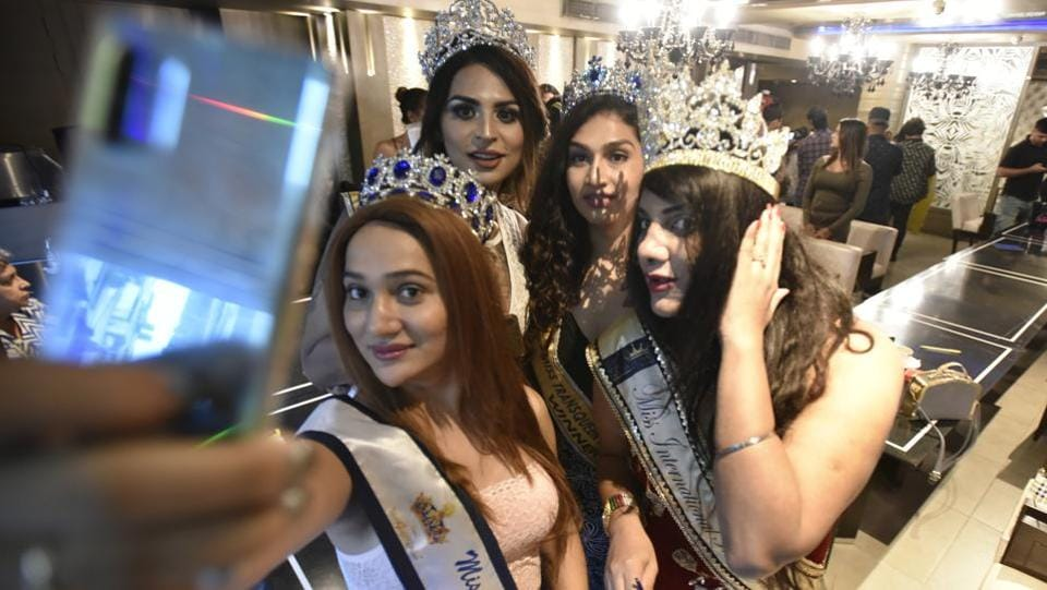 Brand ambassador of the pageant Nabhya Singh takes selfies with winners from previous editions of the contest Namita Ammu, Naaz Joshi and Veena. These transwomen served as role-models to the participants of this year's contest. (Raj K Raj / HT Photo)