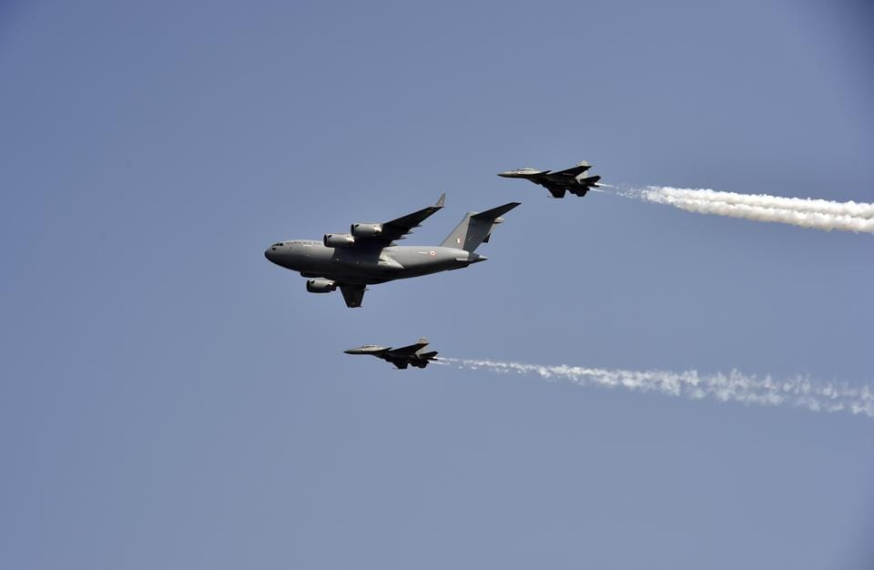 Boeing C-17 Transport Aircraft being flanked by two IAF Sukhoi Su-30MKI fighters during the full dress rehearsal ahead of the 87th Air Force Day at The Air Force Station at Hindon in Ghaziabad.