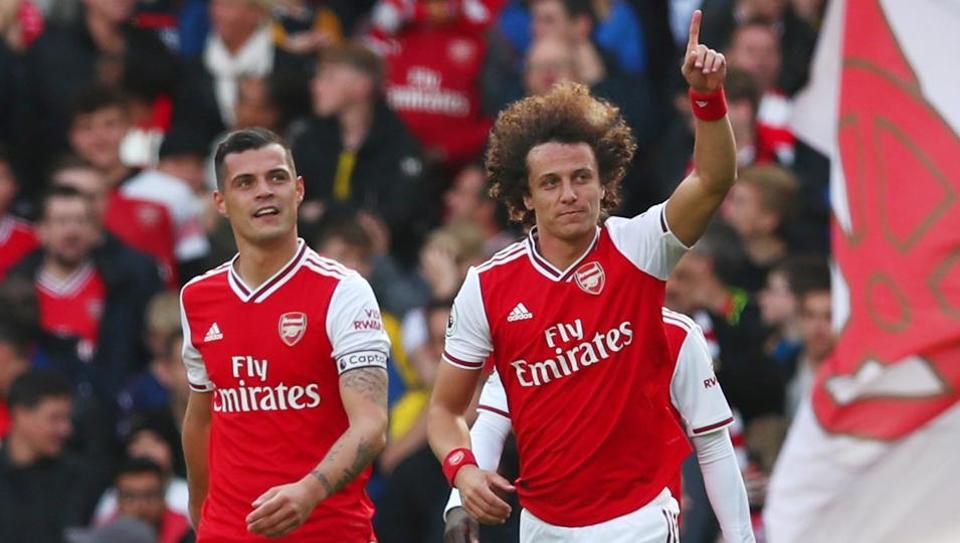 Arsenal's David Luiz celebrates scoring their first goal.