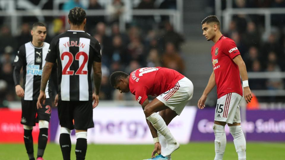 Manchester United's Marcus Rashford puts his boot on during the match.