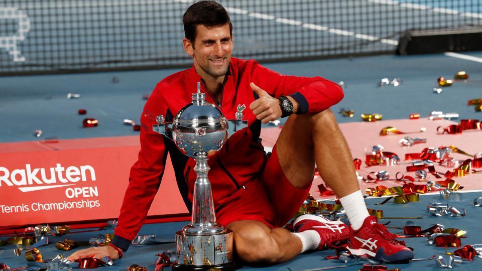 Novak Djokovic of Serbia celebrates with the trophy after winning.