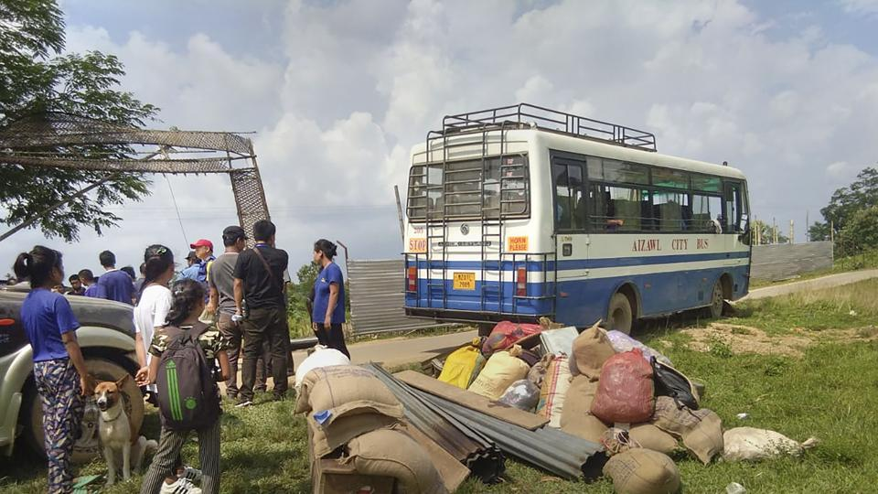 Kanchanpur: Displaced Bru refugee families board a bus to return to Mizoram as part of a home ministry-sponsored rehabilitation programme, in Kanchanpur, Tripura. M