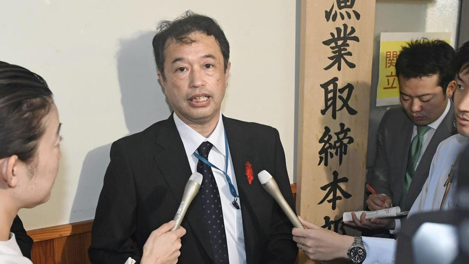 An official of the Japanese Fisheries Agency speaks to media following a collision between its patrol boat and a North Korean fishing boat, in Tokyo.
