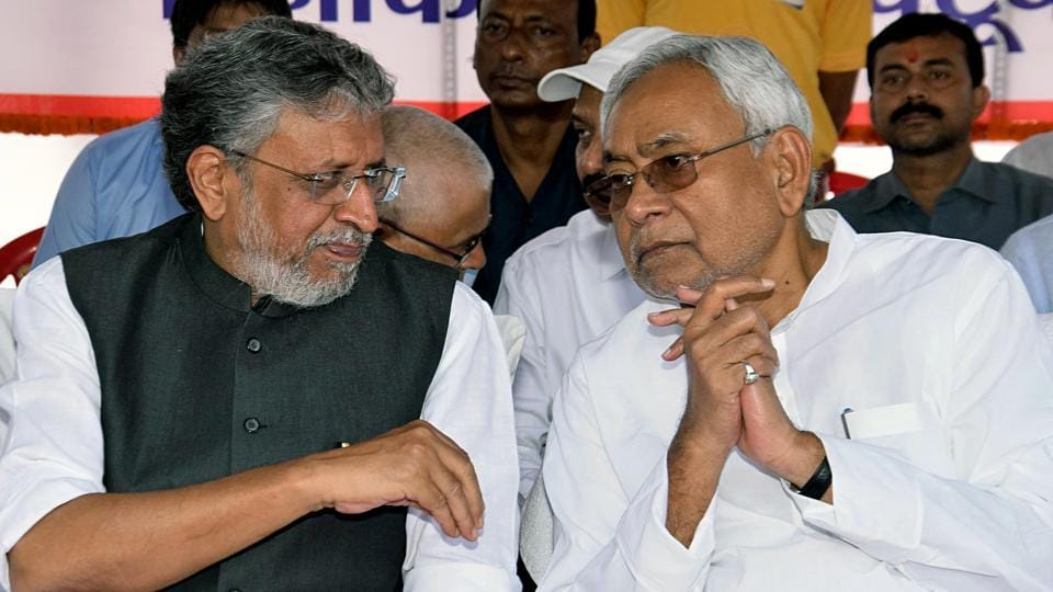Bihar deputy chief minister Sushil Kumar Modi in conversation with CM  Nitish Kumar during an event in Patna.
