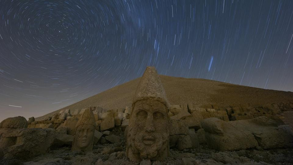 Massive stone head statues are seen at the archaeological site of Mount Nemrut in Adiyaman, southeastern Turkey, a UNESCO World Heritage Site since 1987. The ancient site includes giant 10-meter high, seated statues of King Antiochus I himself surrounded by ancient Gods, including Zeus and Apollo. (Emrah Gurel / AP)