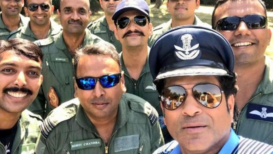 Sachin Tendulkar poses for a photo with Indian Air Force officers.
