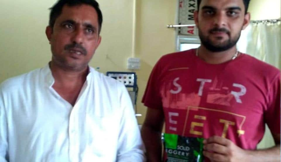 Farmer Yogesh Siwach and his son Shivam showing packets of 'gur' they prepare for different companies.