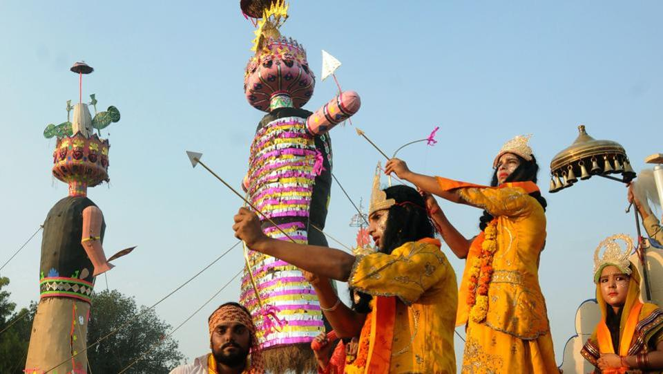 Devotees dressed as Lord Rama and Laxman aim a bow and arrow towards an effigy of the Hindu king Ravana, on the occasion of Dusshera. The festival marks the end of Ramlila and remembers Lord Ram's victory over king Ravana. (PTI)
