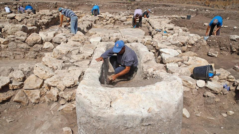 """We have here an immense urban construction, planned with streets that separate neighbourhoods and public spaces,"" Yitzhak Paz of the Israel Antiquities Authority said at the site near the Mediterranean in the country's centre. (Jack Guez / AFP)"