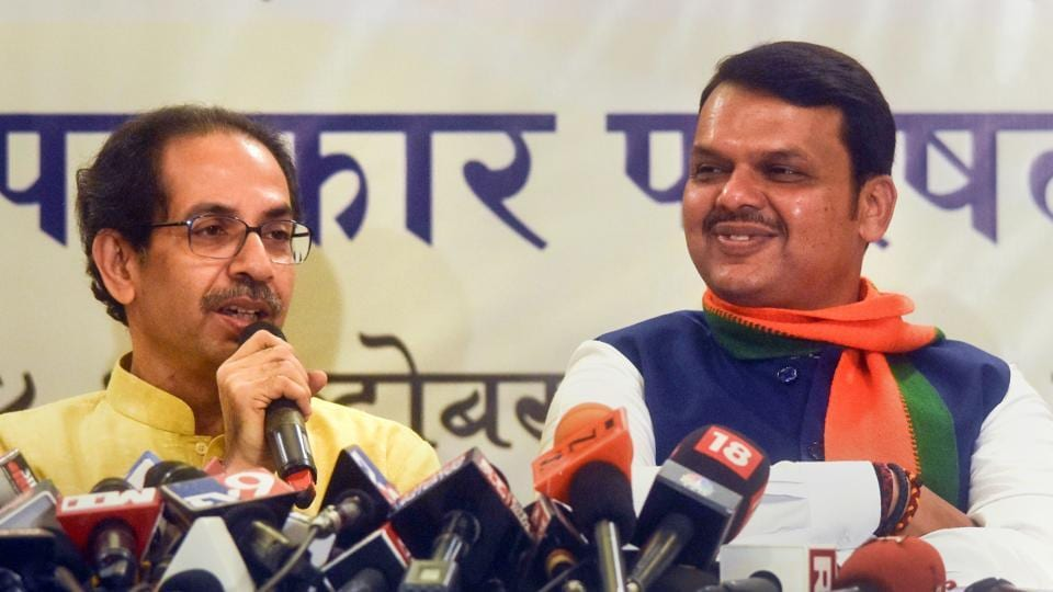 Maharashtra Chief Minister Devendra Fadnavis with Shiv Sena Chief Uddhav Thackeray announces alliance between the two parties for the upcoming assembly election in the state, in Mumbai, Friday, Oct. 4, 2019.