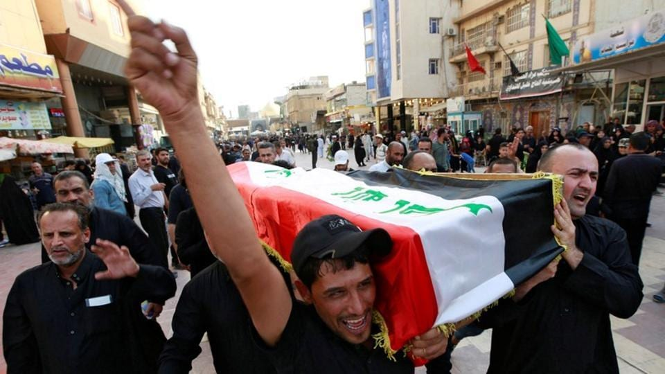 Iraqi men carry the coffin of a demonstrator, who was killed during anti-government protests, at a funeral in Najaf, Iraq.
